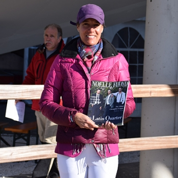 CSI Aachen 2016 - Luciana Diniz reading the Noelle Floyd Magazine